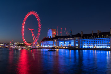 Evening at the London Eye and the River Thames in London, UK