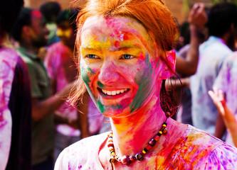 European girl celebrate festival Holi in Delhi, India.