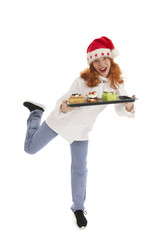 Female baker chef with hat of Santa Claus dancing with Christmas