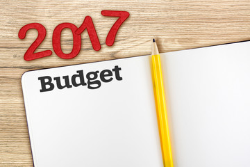 Top view of 2017 new year red number with budget open notebook a
