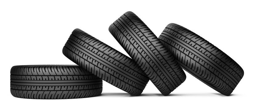 Pile of four black wheel tyres for car