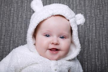 baby in white bear costume