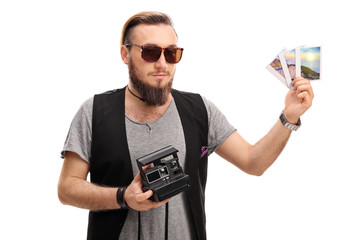 Hipster posing with a polaroid camera