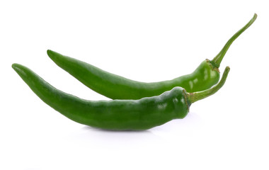 Wall Mural - Green chilli pepper on white background