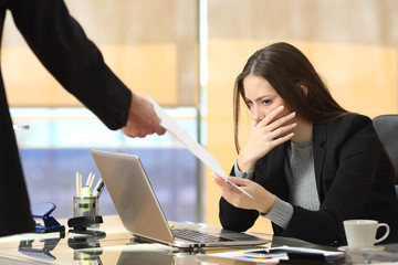 Worried businesswoman receiving notification