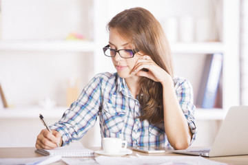 Young businesswoman dealing with paperwork