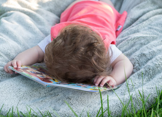 The little girl fell asleep on the book