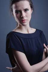 Face of beautiful young woman with brown make-up and straight hair