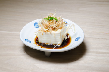 Japanese tofu, Japanese soft cold tofu with sauce in a dish on d