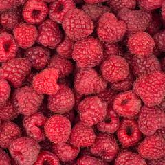 Fresh raspberries background closeup photo.
