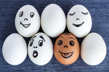Funny eggs with faces, one is red, another surprised