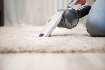 Process of cleaning carpet with help portable vacuum cleaner