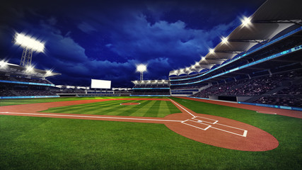 illuminated modern baseball stadium with spectators and green grass