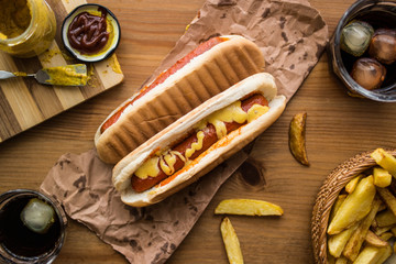 Hot Dog Sandwich with Yellow Mustard, Beverage and Potatoes.