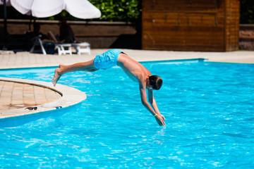 Boy diving in swimming pool