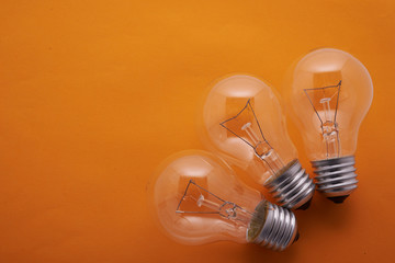 three arc lamps set on an orange background