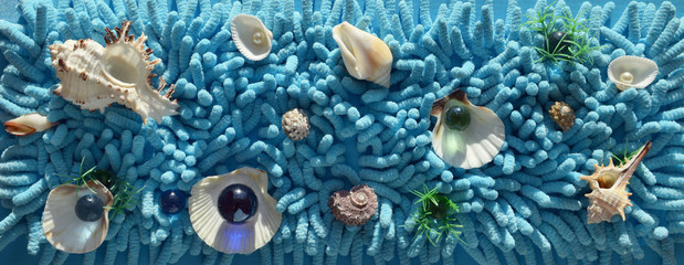 Sea shell  abstract design on a textured turquoise blue backgrou