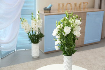 Contemporary interior with bouquet of flowers in vase