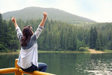 Girl on mountain lake background