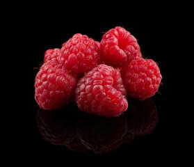 Fresh raspberries on black background