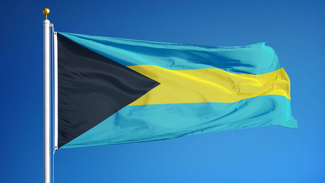 Bahamas flag waving against clean blue sky, close up, isolated with clipping mask alpha channel transparency, perfect for film, news, digital composition