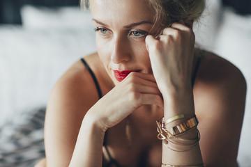 Sensuous woman looking away in bedroom