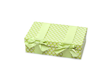 Single green gift box with ribbon on isolated white background