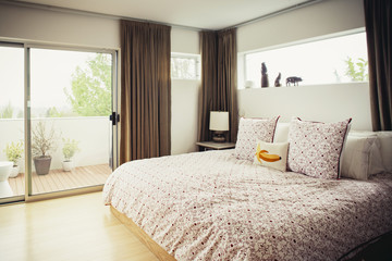 Pillows on bed at brightly lit bedroom