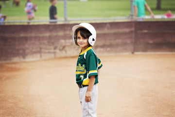 Smiling boy standing on playing field