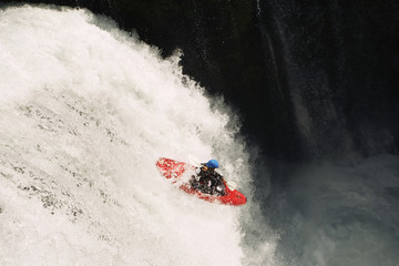 Kayaker descending from waterfall