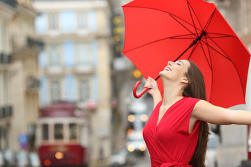 Happy woman breathing in the street