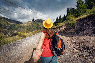 Beautiful woman with backpack in the mountains