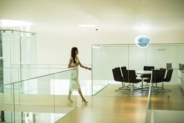 Woman walking in the modern building