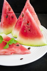 Slices of watermelon on a white plate
