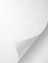 Photo of blank folded sheet of paper with curled corner
