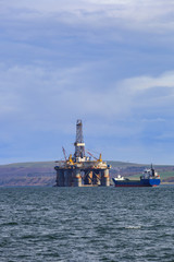 Semi Submersible Oil Rig at Cromarty Firth during Sunset Time in