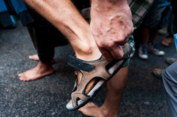 detail of bare feet during bare foot march in favour of refugees in rome