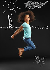 Happy African girl jumping on black background
