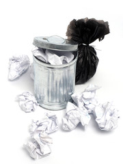 metal garbage bin and paper trash on white background