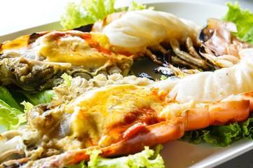 Grilled big shrimp served with fresh lettuce