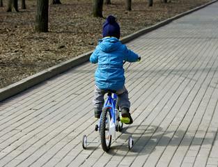 Kid on the bike.