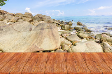 Wood table top on blurred beach background - can be used for dis
