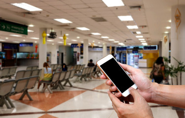 Human holding blank screen of smart phone and waiting arrivals t