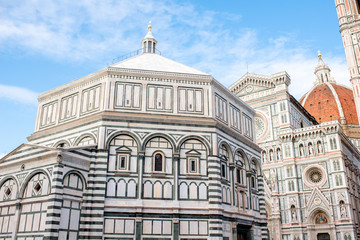 Famous Santa Maria del Fiore cathedral church with Baptistery in Florence. Close-up view from below