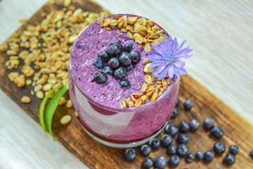 Blueberry yogurt in a glass for Breakfast. Pudding with juicy bl