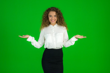 The beautiful woman stand on the green background