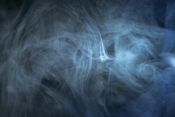 The stream of thick fume on a dark background