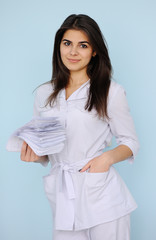 woman doctor with medical certificates