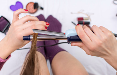 point of view of woman using curling iron