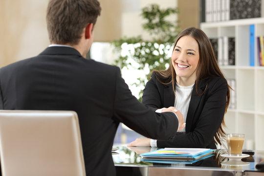 Businesspeople handshaking after negotiation